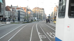 Tram drives down the Street in Central Amsterdam Netherlands Stock Footage