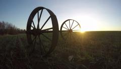 Landscape with two iron wheels and trees in young wheat field, time lapse 4K Stock Footage