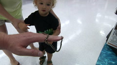 Little Boy Looking At Snake In Pet Store - stock footage