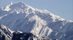 Panning shot of snow cover mountains in the Wasatch range, Utah. Stock Footage