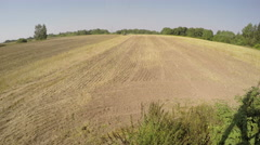 Tractor plowing field on sunny autumn's day, time lapse 4K Stock Footage
