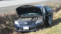 Damaged Car in Ditch Stock Footage