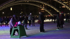 Ice Skaters at Nathan Phillip's Square, Toronto Sign at Night Stock Footage