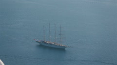 Ship floats on the clear blue Mediterranean Sea Stock Footage
