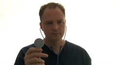 Doctor Holding Stethoscope Listening To Heart Stock Footage
