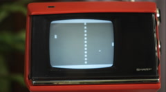 Tight shot of a retro TV with Pong being played on the screen. Stock Footage