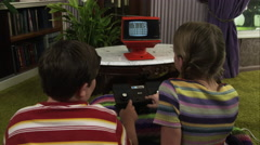 Two children playing on an Atari Super Pong console. Stock Footage