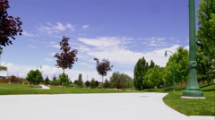 City park seen from a low angle just above the sidewalk. Stock Footage
