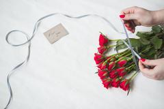 Woman making bouquet Stock Photos