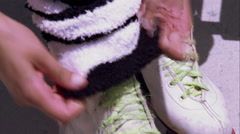 Extreme tight shot of a woman adjusting leg warmers on her roller skates. Stock Footage