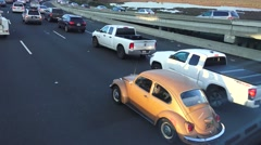 Old VW beetle San Francisco freeway Stock Footage