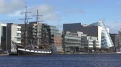 Dublin River Liffey Tall Ship Convention centre Stock Footage