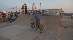 Athlete Making Tricks on A BMX Bicycle on a Ramp during the competition. - stock footage