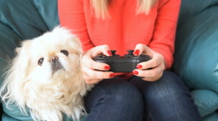 Young woman playing video game using a game pad. Stock Footage