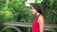 Happy woman walking on bridge in jungle, super slow motion 240fps Stock Footage