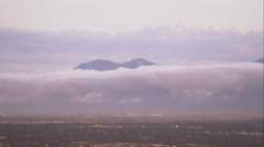Panning shot of the Salt Lake Valley with clouds clinging to the mountains. Stock Footage