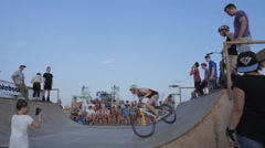 Young Man Jumping And Riding on a BMX Bicycle on a ramp during the BMX - stock footage