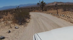 Viewpoint Driving On Dirt Road In Saddleback Butte State Park Stock Footage