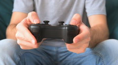 Male hands holding video game controller. Stock Footage