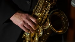 The musician plays the saxophone. Close up of the fingers pressing the keys of - stock footage