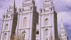 Tilting up shot of the front of the LDS Salt Lake Temple from a diagonal angle. - stock footage
