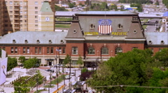 Panning shot of downtown Salt Lake City, including the Union Station building Stock Footage