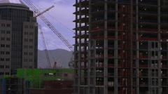Panning shot of highrise buildingings in Salt Lake City one of which is under Stock Footage