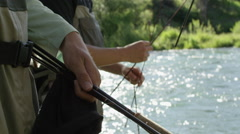 Men preparing for fly fishing Stock Footage