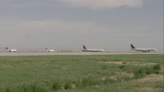 Airport runway with several planes, one taking off. Salt Lake Airport. Stock Footage