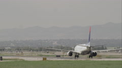 Following shot of an airplane taking off at the Salt Lake Airport. Stock Footage
