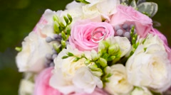 Two wedding rings on a bouquet Stock Footage