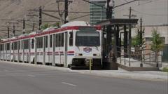 Tram in Salt Lake City leaving stop. Stock Footage
