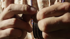 Man tying a snell knot on fishing bait Stock Footage
