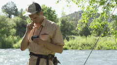 Man preparing fly line for fishing Stock Footage