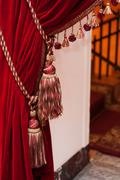 beautiful decorated red curtains with tassels - stock photo
