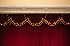 beautiful decorated red curtains in theater top part - stock photo