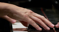 Tight shot with narrow field of focus of hands playing the piano. Stock Footage
