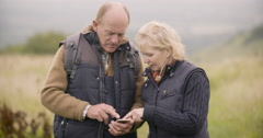 Couple looking at gps on cellphone - stock footage