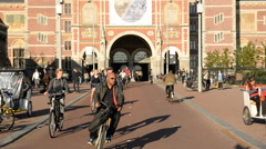 Time lapse of Bicyclists & Pedestrians - Rijksmuseum Building - Amsterdam Stock Footage