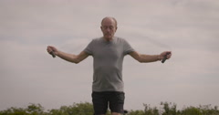 Elderly man exercising with skipping rope Stock Footage