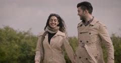 Couple walking in field Stock Footage