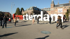 Amsterdam Sign & People - Rijksmuseum - Amsterdam Netherlands - stock footage
