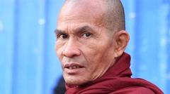 Portrait monk collect alms in the street food market . Yangon, Myanmar, Burma Stock Footage