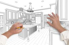 Male Hands Sketching with Pencil the Outline of a Beautiful Custom Kitchen. Stock Photos