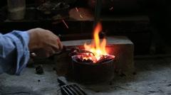 Melting silver in a jewelry workshop. Inle lake, Myanmar, Burma Stock Footage