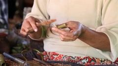 Stock Video Footage of Old women make local cigars . Inle Lake, Myanmar.