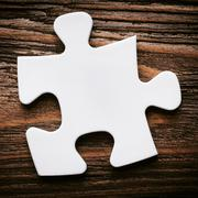 Placing missing a piece of puzzle. business concept. Stock Photos