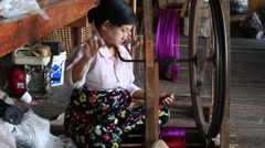 Stock Video Footage of Burmese textile manufacturer in craft village where old women work. Myanmar
