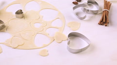 Baking heart shaped sugar cookies for Valentines Day. Stock Footage