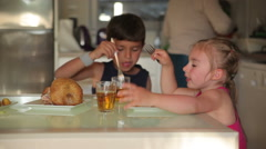 Children dine chicken with potatoes - stock footage